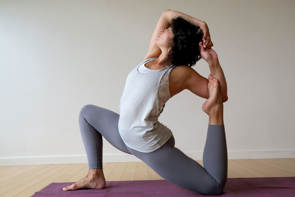 Modified variation of mermaid yoga pose